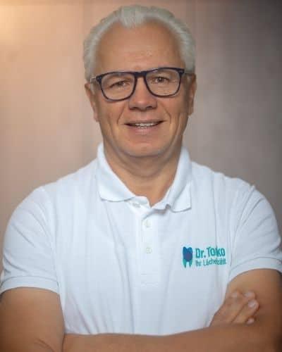 Dr. med. dent. Tomko